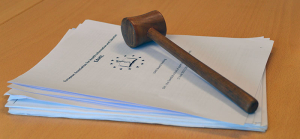 Gavel and papers.