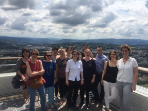 Group of smiling workshop participants and a lovely Basel view.