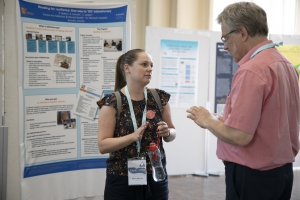 posters, two people, at EAHIL2019 workshop.